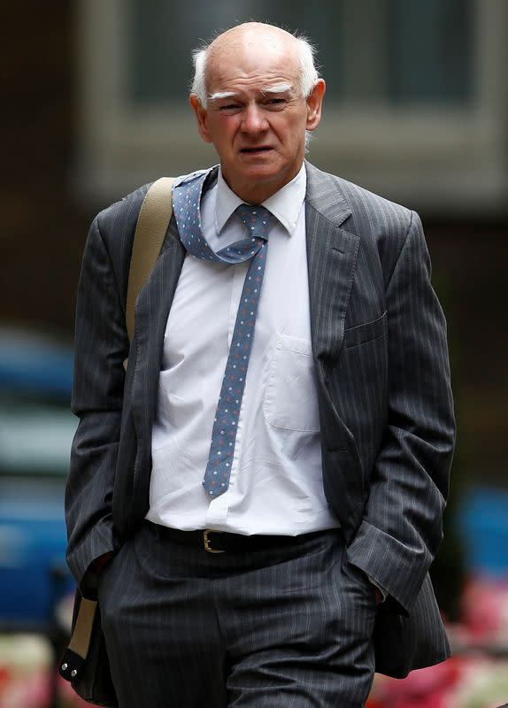 FILE PHOTO: Howard Davies, Chairman of The Royal Bank of Scotland, arrives for a meeting with Britain's Chancellor of the Exchequer, George Osborne, at Downing Street in London