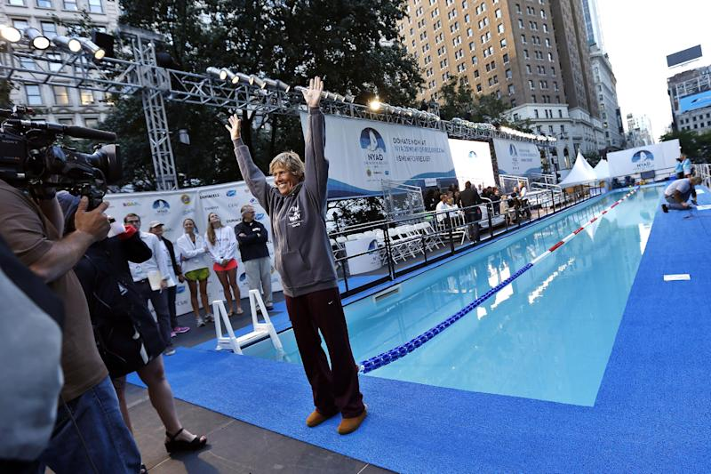 "Long-distance swimmer Diana Nyad, who recently completed a record-breaking swim from Cuba to Florida, greets the media before beginning a continuous 48-hour marathon swim event in New York's Herald Square called ""Swim for Relief,"" which aims to raise funds and awareness for Hurricane Sandy recovery efforts, Tuesday, Oct. 8, 2013. (AP Photo/Jason DeCrow)"