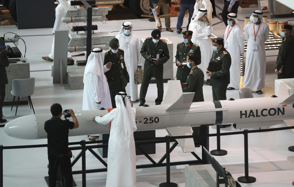 A military delegation visit the display of Halcon, a regional leader in the end-to-end manufacturing of precision-guided systems, during the opening day of the International Defence Exhibition & Conference, IDEX, in Abu Dhabi, United Arab Emirates, Sunday, Feb. 21, 2021. (AP Photo/Kamran Jebreili)