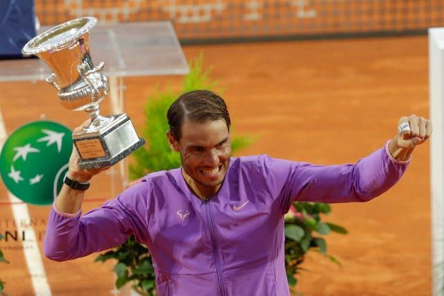 Spain's Rafael Nadal celebrates with the trophy after winning the Italian Open