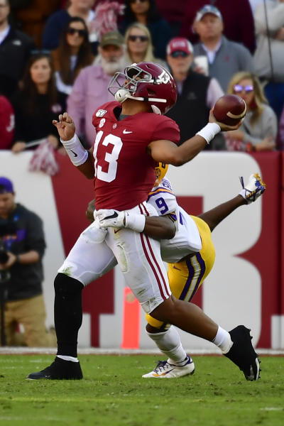 Alabama quarterback Tua Tagovailoa (13) is hit by LSU safety Marcel Brooks (9) as he throws a pass in the first half of an NCAA college football game, Saturday, Nov. 9, 2019, in Tuscaloosa, Ala. (AP Photo/Vasha Hunt)