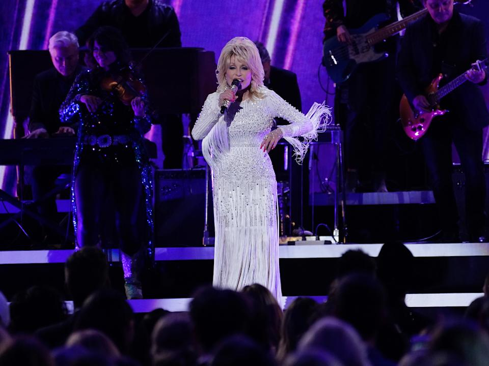 NASHVILLE, TENNESSEE - NOVEMBER 13:  (FOR EDITORIAL USE ONLY)  Dolly Parton performs onstage at the 53rd annual CMA Awards at the Bridgestone Arena on November 13, 2019 in Nashville, Tennessee. (Photo by Mickey Bernal/WireImage)