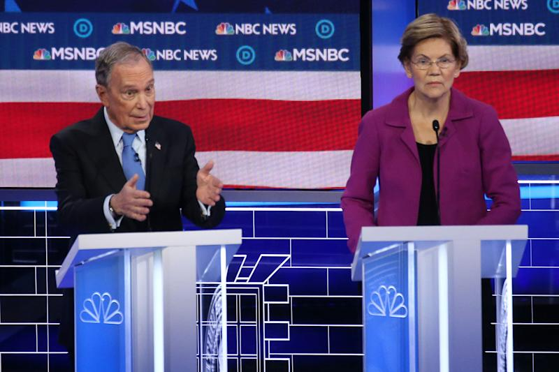 Democratic presidential candidates Mike Bloomberg and Sen. Elizabeth Warren (D-Mass.) sparred over nondisclosure agreements at the Democratic presidential primary debate Wednesday in Las Vegas. (Photo: Mario Tama via Getty Images)