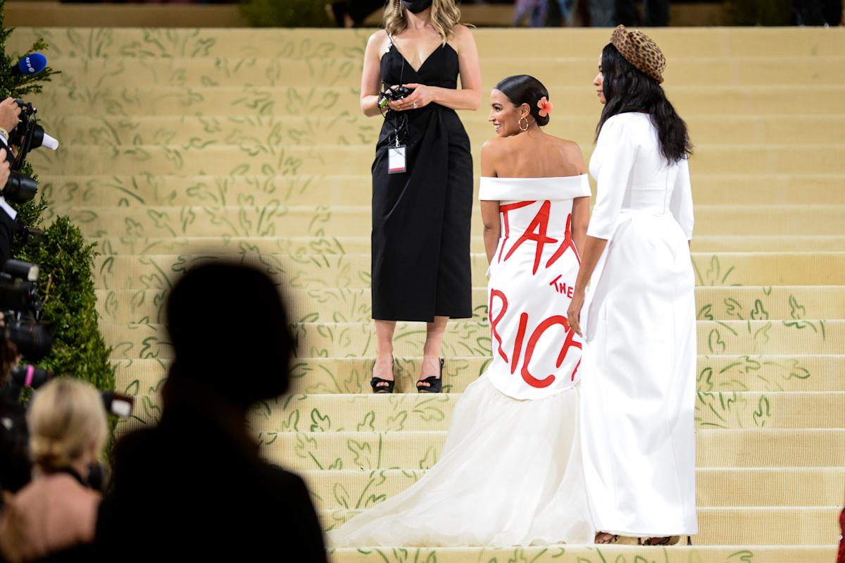 Alexandria Ocasio-Cortez's Met Gala gown message sparked controversy. Why 'slogan fashion' is returning to red carpets.