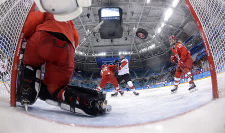 Ice Hockey - Pyeongchang 2018 Winter Olympics - Women's Semifinal Match - Canada v Olympic Athletes from Russia - Gangneung Hockey Centre, Gangneung, South Korea - February 19, 2018 - Jenn Wakefield of Canada (L) scores a third period goal past goalie Nadezhda Aleksandrova, an Olympic Athlete from Russia. REUTERS/Matt Slocum/Pool