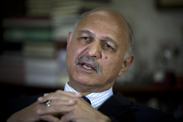 In this Nov. 30, 2018 photo, Mushahid Hussain, chairman of Pakistan's Senate Foreign Affairs Committee, speaks to The Associated Press in Islamabad, Pakistan. Hussain said the cardinal principle of Pakistan-China relations is to refrain from commenting on anything to do with the other country's domestic issues. But scores of Pakistani men whose Muslim Uighur wives have disappeared into internment camps in China feel helpless, fighting a wall of silence as they struggle to reunite their families. (AP Photo/B.K. Bangash)
