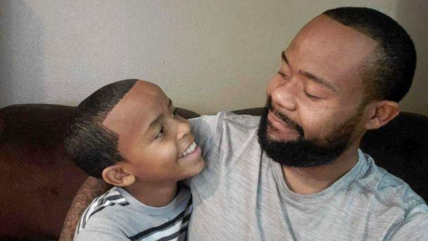 PHOTO: Shyon Clark and his dad, Johnnie Clark, embrace in a hug in this undated family photo. (Courtesy Johnnie Clark)