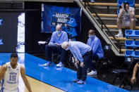 North Carolina head coach Roy Williams reacts after a turnover during the second half of a first-round game against Wisconsin in the NCAA men's college basketball tournament, Friday, March 19, 2021, at Mackey Arena in West Lafayette, Ind. (AP Photo/Robert Franklin)