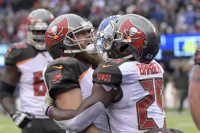 Tampa Bay Buccaneers quarterback Ryan Fitzpatrick, left, celebrates his touchdown with Peyton Barber during the first half of an NFL football game against the New York Giants, Sunday, Nov. 18, 2018, in East Rutherford, N.J. (AP Photo/Bill Kostroun)