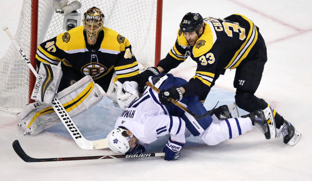 Boston Bruins defenseman Zdeno Chara (33) hits Toronto Maple Leafs center Zach Hyman (11) during the first period of Game 7 of an NHL hockey first-round playoff series in Boston, Wednesday, April 25, 2018. At left is Bruins goaltender Tuukka Rask. (AP Photo/Charles Krupa)