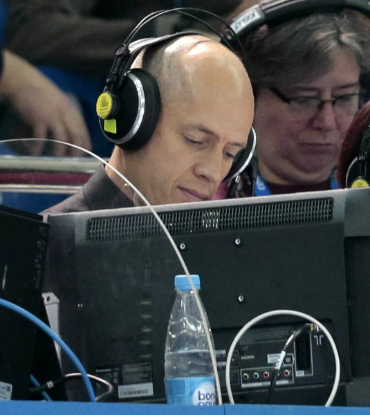 "In this Feb. 13, 2014 photo, former U.S. Olympic figure skater Scott Hamilton works as a commentator for NBC television during the men's short program figure skating competition at the 2014 Winter Olympics in Sochi, Russia. Thirty years ago, Hamilton won the figure skating gold medal in Sarajevo. His victory was the culmination of a four-year winning streak that would seem impossible nowadays. ""Everything I did in those four years peaked at the Olympics,"" he says. (AP Photo/Ivan Sekretarev)"