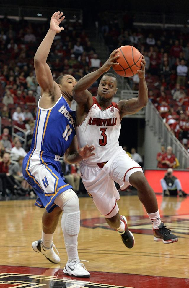 Louisville's Chris Jones, right, attempts to drive around the defense of Hofstra's Dion Nesmith during the second half of an NCAA college basketball game Tuesday, Nov. 12, 2013, in Louisville, Ky. Louisville won 97-69. (AP Photo/Timothy D. Easley)