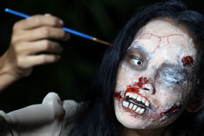 Thai woman livestreams selling dead people's clothes in zombie make up