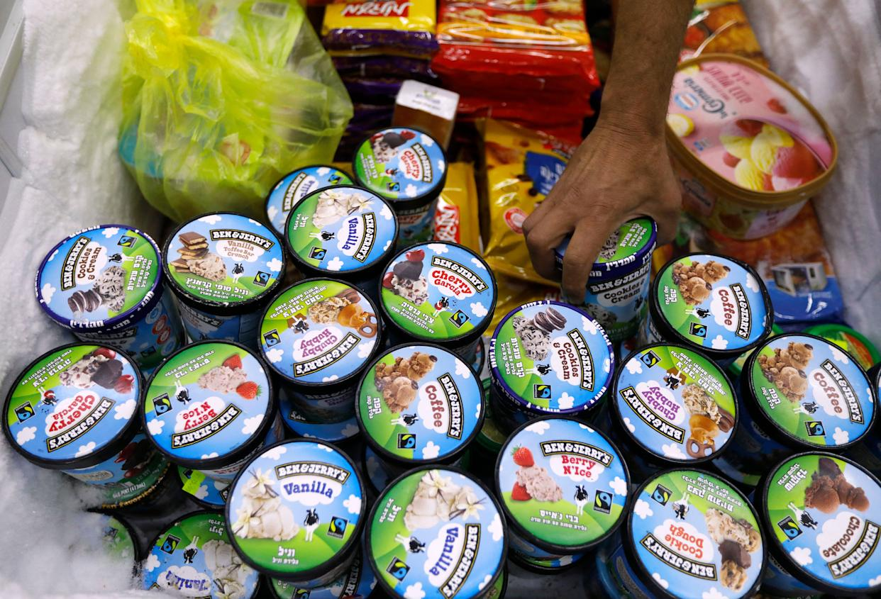 A man buys Ben & Jerry's ice cream in Jerusalem on July 20, 2021. - Ice cream-maker Ben & Jerry's announced they would stop selling their ice cream in the occupied Palestinian territories.