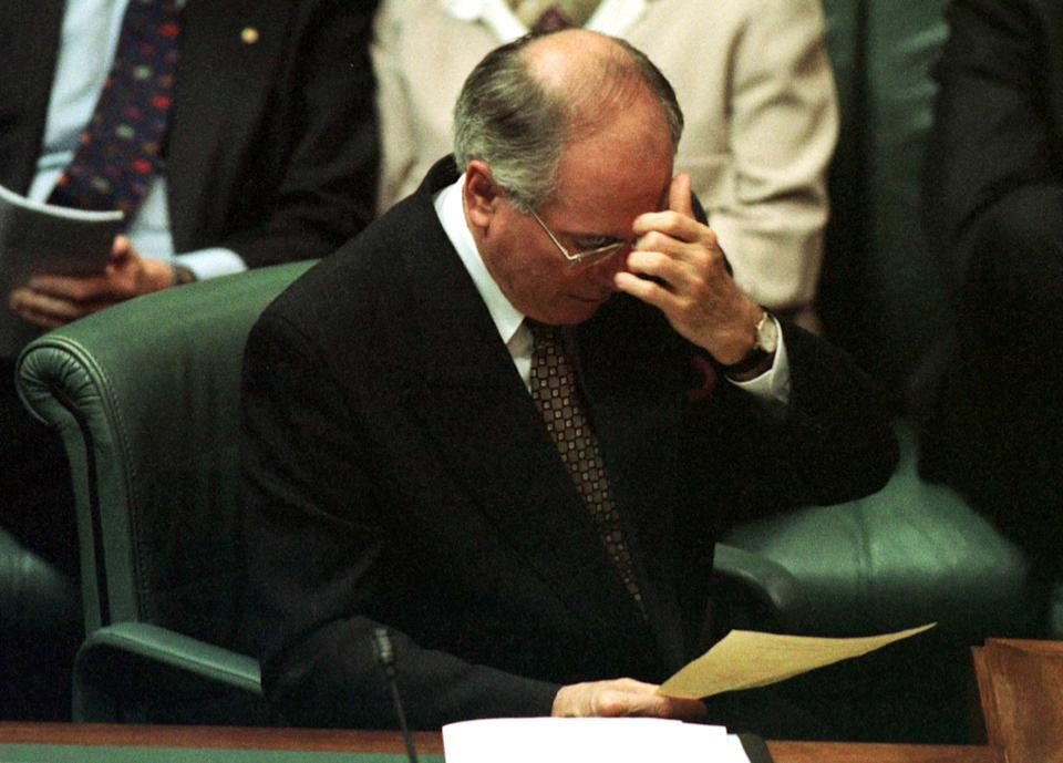 Prime Minister John Howard with his head in his hand in parliament in 1998.