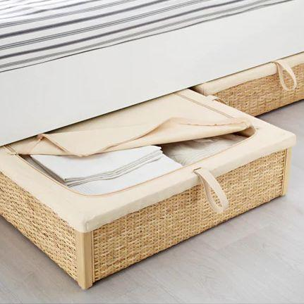 """Keep your shoes and sheets tucked away under your bed in this trendy rattan baskets. <a href=""""https://fave.co/2YsC2V9"""" target=""""_blank"""" rel=""""noopener noreferrer"""">Find it for $50 at IKEA.</a>"""