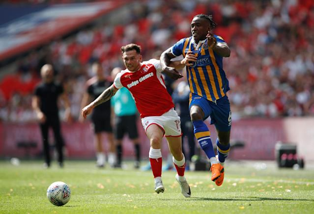 "Soccer Football - League One Play-Off Final - Rotherham United v Shrewsbury Town - Wembley Stadium, London, Britain - May 27, 2018 Rotherham's Jon Taylor in action with Shrewsbury Town's Omar Beckles Action Images/Carl Recine EDITORIAL USE ONLY. No use with unauthorized audio, video, data, fixture lists, club/league logos or ""live"" services. Online in-match use limited to 75 images, no video emulation. No use in betting, games or single club/league/player publications. Please contact your account representative for further details."