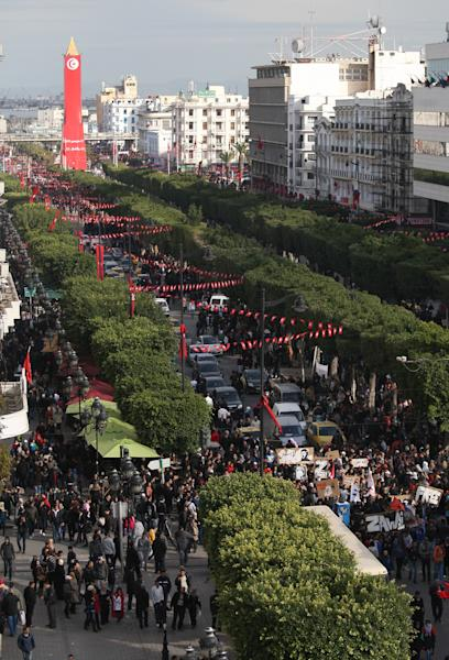 Tunisians demonstrate on Tunis's main avenue to mark the second anniversary of the Revolution, Monday, Jan. 14. 2013. Two years after the revolution that overthrew an authoritarian president and started the Arab Spring, Tunisia is struggling with high unemployment and rising violence in its politics. (AP Photo/Amine Landoulsi)