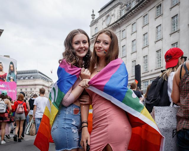 Women wrapped in a rainbow flag along Oxford Circus during London Pride 2019 (Photo by Belinda Jilao / SOPA Images/Sipa USA)