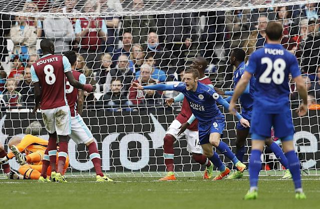 <p>Leicester's Jamie Vardy, center, celebrates after scoring during the English Premier League soccer match between West Ham and Leicester City at London Stadium in London, Saturday, March 18, 2017. (AP Photo/Frank Augstein) </p>