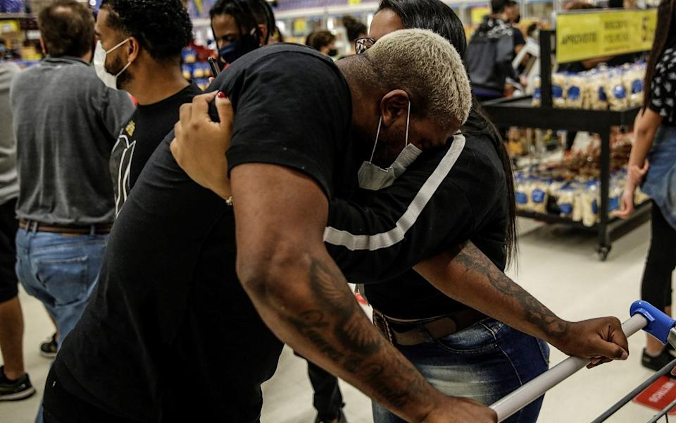 A man cries during a protest at a Carrefour supermarket after the death of Alberto Silveira Freitas - Shutterstock