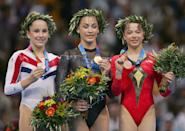 ATHENS - AUGUST 23: (L-R) Carly Patterson of United States (silver), Catalina Ponor of Romania (gold) and Alexandra Georgiana Eremia of Romania (bronze) receive their medals for the women's artistic gymnastics balance beam event on August 23, 2004 during the Athens 2004 Summer Olympic Games at the Olympic Sports Complex Indoor Hall in Athens, Greece. (Photo by Ezra Shaw/Getty Images)