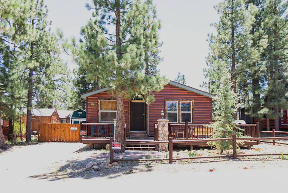 """<h2>Big Bear Lake, California</h2><br><strong>Location:</strong> Boulder Bay, CA<br><strong>Sleeps:</strong> 7<br><strong>Price Per Night:</strong> <a href=""""http://airbnb.pvxt.net/QVZvx"""" rel=""""nofollow noopener"""" target=""""_blank"""" data-ylk=""""slk:$375"""" class=""""link rapid-noclick-resp"""">$375</a><br><br>""""Whispering Pines Lodge is the perfect getaway for family and friends! Centrally located in Big Bear Lake, it is the perfect location. You can walk to Lake Marina to rent boats or kayaks, and you are just a couple minutes away from shopping at the Village or hitting the slopes.""""<br><br><h3>Book <a href=""""http://airbnb.pvxt.net/QVZvx"""" rel=""""nofollow noopener"""" target=""""_blank"""" data-ylk=""""slk:Beautiful Log Cabin"""" class=""""link rapid-noclick-resp"""">Beautiful Log Cabin</a></h3> <br><br>"""