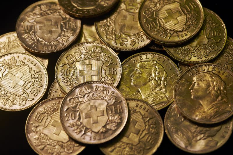 Twenty Swiss francs gold coins, known as Vrenelis, are pictured at Jolliet numismatic shop in Geneva