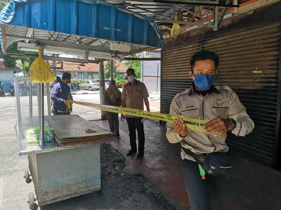 The authorities sealed off the Pulau Tikus market today after it was ordered to close from today onwards. — Picture courtesy of MBPP