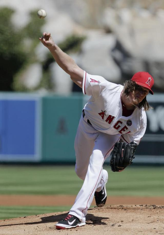 Los Angeles Angels starting pitcher Jered Weaver throws to an Oakland Athletics batter during the first inning of a baseball game in Anaheim, Calif., Wednesday, Sept. 25, 2013. (AP Photo/Chris Carlson)