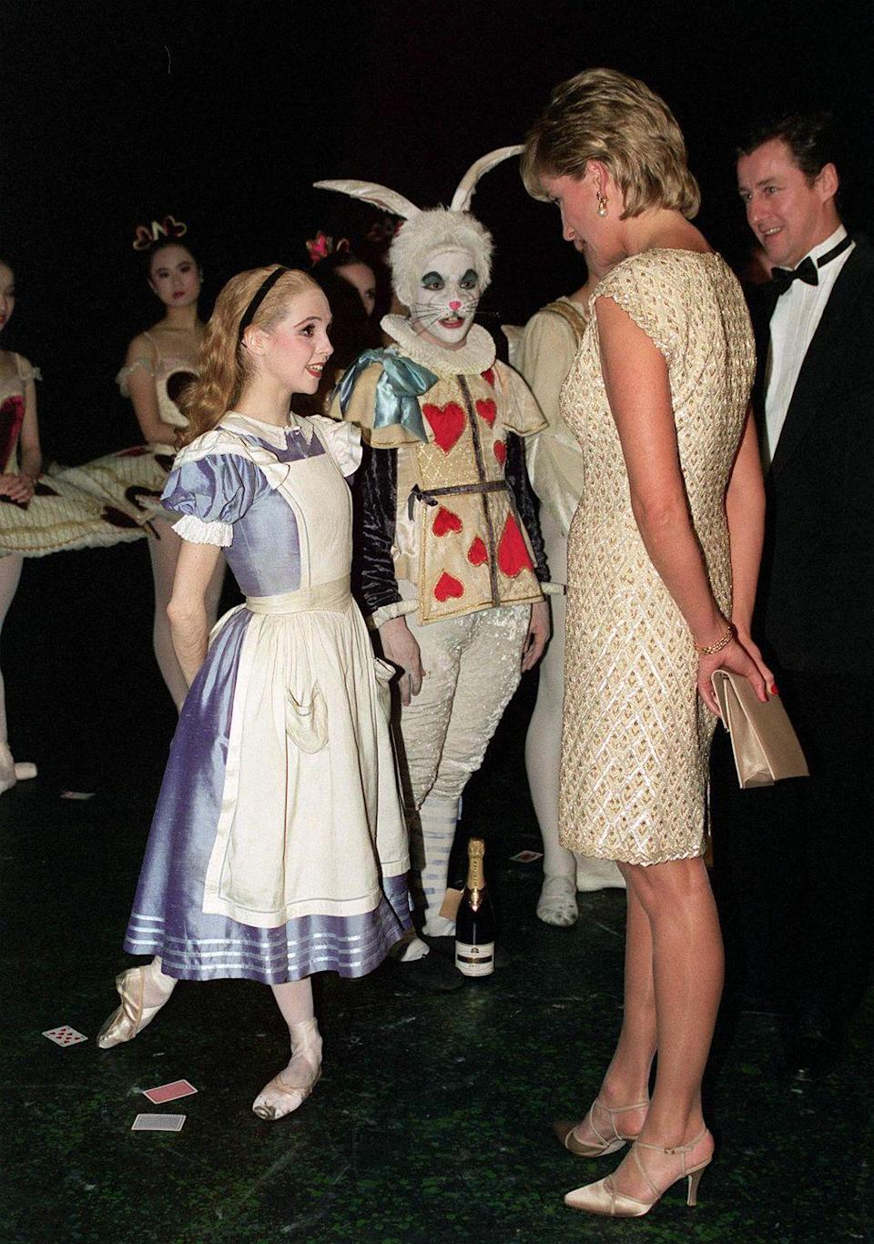 """<p>In her role as patron of the English National Ballet, Princess Diana attends a performance of """"Alice in Wonderland"""" in 1996. </p>"""