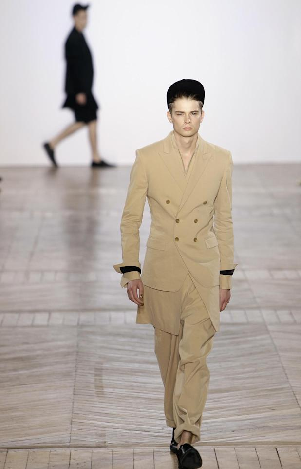 A model wears a creation by Korean fashion designer Juun.J as part of his Men's Spring-Summer 2013 collection, for the Paris Fashion Week, in Paris, France, Friday, June 29, 2012. (AP Photo/Francois Mori)