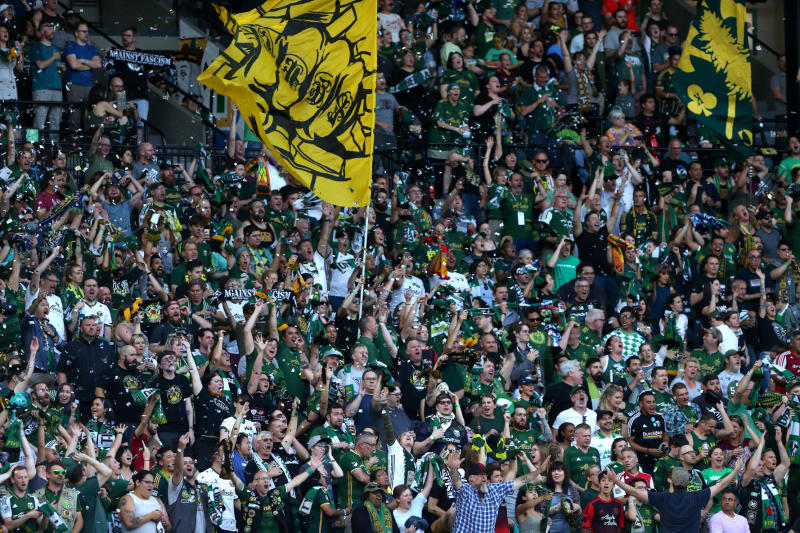Portland Timbers fans cheer during an MLS soccer match between the Timbers and Atlanta United in Portland, Ore., on Sunday, Aug. 18, 2019. (Sean Meagher/The Oregonian via AP)