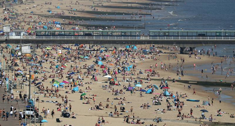 Hundreds of people pictured on Bournemouth beach on Wednesday after lockdown restriction were relaxed. Source: AAP