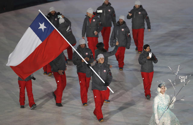 <p>Henrik Von Appen carries the flag of Chile during the opening ceremony of the 2018 Winter Olympics in Pyeongchang, South Korea, Friday, Feb. 9, 2018. (AP Photo/Michael Sohn) </p>