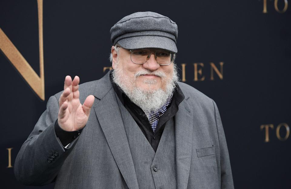 """Author George R.R. Martin waves to photographers at the premiere of the film """"Tolkien,"""" at the Regency Village Theatre, Wednesday, May 8, 2019, in Los Angeles. The film explores the formative years of J.R.R. Tolkien, author of the classic fantasy novels """"The Hobbit"""" and """"The Lord of the Rings."""" (Photo by Chris Pizzello/Invision/AP)"""