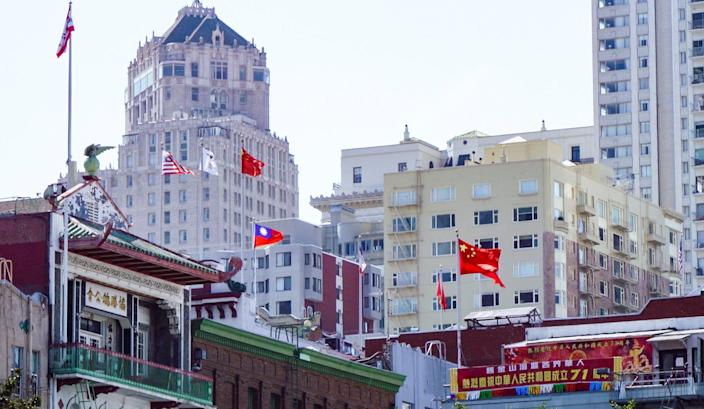 Various flags hang in San Francisco's Chinatown on Sept. 28, 2020. The area has been a magnet for Chinese immigrants since the 19th-century Gold Rush and is home to densely packed single-room-occupancy housing that many fear will accelerate COVID-19 outbreaks.