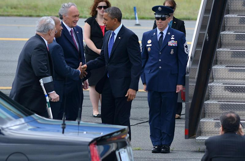 President Barack Obama is greeted by, from left, Boston Mayor Tom Menino, Massachusetts Gov. Deval Patrick, and Senate candidate, Rep. Ed Markey, D-Mass, upon the president's arrivals on Air Force One at Logan International Airport in Boston, Wednesday, June, 12, 2013. Obama was scheduled to attend a fundraiser and rally for Senate candidate, Rep. Ed Markey, D-Mass. (AP Photo/Josh Reynolds)