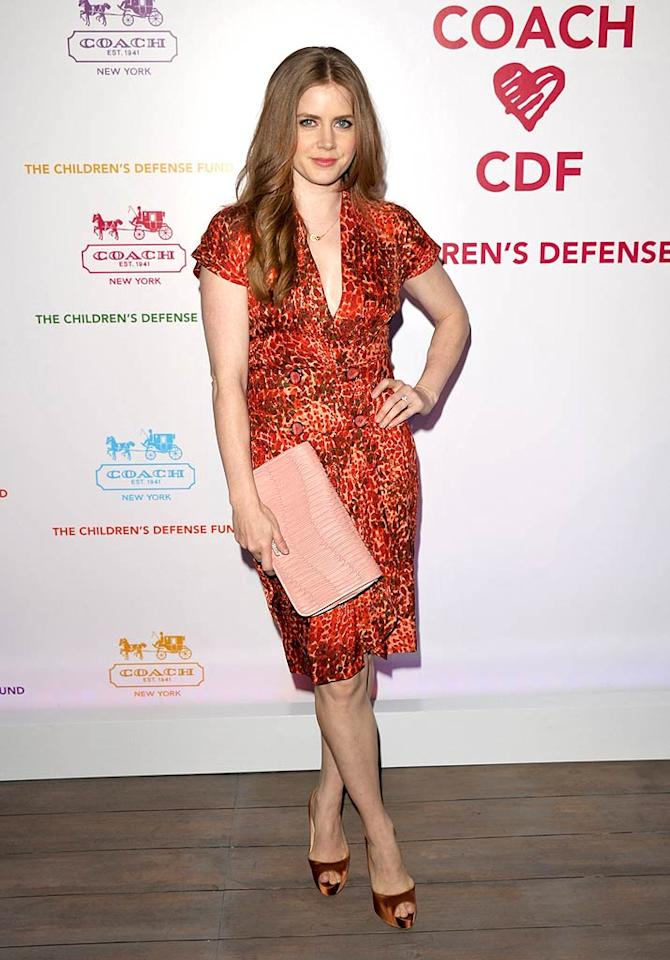 "Amy Adams accessorized her orange printed frock with a pale pink Coach clutch and satin peep-toe heels. John Shearer/<a href=""http://www.gettyimages.com/"" target=""new"">GettyImages.com</a> - April 20, 2011"
