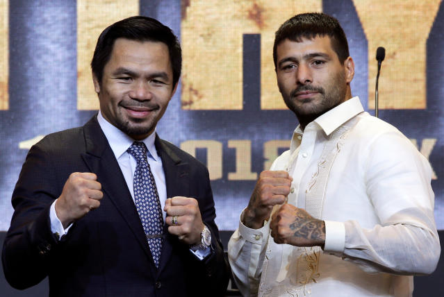 Manny Pacquiao and Argentine WBA welterweight champion Lucas Matthysse pose for photographers during a press conference in Manila, Philippines on Wednesday, April 18, 2018. (AP Photo)