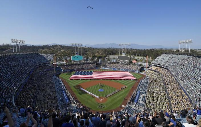 Four F-15 Eagles from the Air National Guard fly over Dodger Stadium during the national anthem.