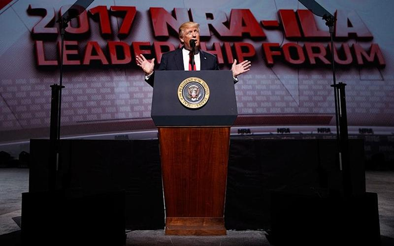 President Donald Trump speaks at the National Rifle Association Leadership Conference - AP Photo/Evan Vucci