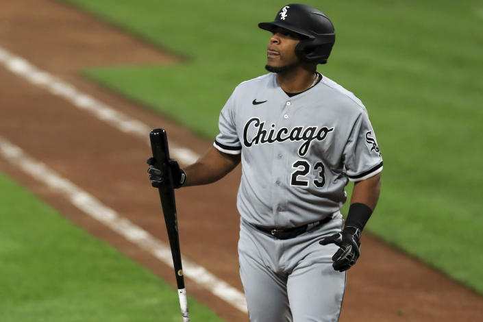 FILE - In this Sept. 18, 2020, file photo, Chicago White Sox' Edwin Encarnacion reacts during a baseball game against the Cincinnati Reds in Cincinnati. About 50 players would be eligible for free agency if their options are declined by Sunday, among them the White Sox designated hitter Edwin Encarnacion. (AP Photo/Aaron Doster, File)