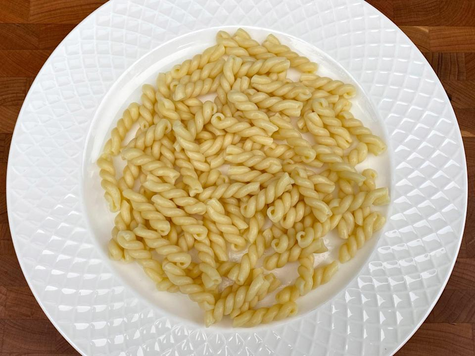 <p>1/2 cup of uncooked pasta or 1 1/2 cups of cooked pasta</p>