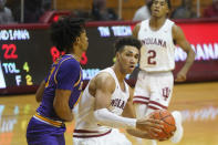 Indiana's Trayce Jackson-Davis (23) goes to the basket against Tennessee Tech's Kenny White Jr. (13 during the first half of an NCAA college basketball game, Wednesday, Nov. 25, 2020, in Bloomington, Ind. (AP Photo/Darron Cummings)
