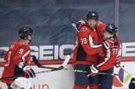 Washington Capitals right wing Anthony Mantha (39) celebrates his goal with right wing T.J. Oshie (77) and defenseman Dmitry Orlov (9) during the second period of an NHL hockey game against the Philadelphia Flyers, Tuesday, April 13, 2021, in Washington. (AP Photo/Nick Wass)