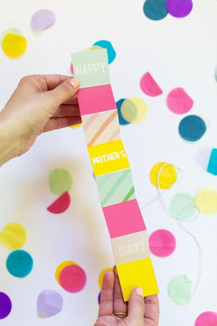 """<p>This year, celebrate Mom with a collection of colors and an unexpected format: an accordion-style card. Nothing's more fun to open than this!</p><p><strong>Get the printable at <a href=""""https://lovelyindeed.com/printable-mothers-day-accordion-card/"""" rel=""""nofollow noopener"""" target=""""_blank"""" data-ylk=""""slk:Lovely Indeed"""" class=""""link rapid-noclick-resp"""">Lovely Indeed</a>. </strong></p>"""