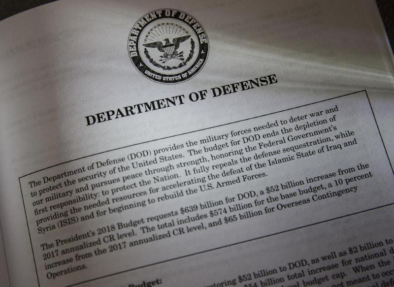 Proposals for the Defense Department in President Donald Trump's first budget are displayed at the Government Printing Office in Washington, Thursday, March, 16, 2017. The $1.15 trillion presentation proposes a reordering of national spending priorities, pumping significantly more money into the military and homeland security while sharply cutting foreign aid, medical research and the arts. The document also proposes money for the U.S.-Mexico border wall Trump vowed in his campaign to have Mexico finance. The EPA also takes a big hit in the budget proposal. (AP Photo/J. Scott Applewhite)