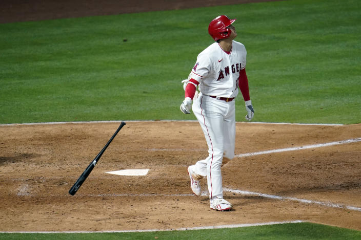Los Angeles Angels' Shohei Ohtani drops his bat as he hits a two-run home run during the sixth inning of a baseball game against the Tampa Bay Rays Monday, May 3, 2021, in Anaheim, Calif. (AP Photo/Marcio Jose Sanchez)