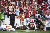 FILE - In this Oct. 6, 2018, file photo, Oklahoma wide receiver Marquise Brown (5) breaks free for a 77-yard touchdown reception against Texas during the second half of an NCAA college football game at the Cotton Bowl in Dallas. No. 5 Oklahoma and No. 9 Texas are playing in a rare Red River rivalry rematch in the Big 12 championship game on Saturday. It is the first time in 115 years that the border state rivals will play twice in the same season. (AP Photo/Cooper Neill, File)